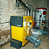 ETA HACK 50KW wood chip boiler installed with 30cubic metre wood chip store for district heating in Devon